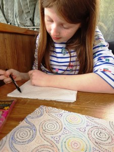Lily-Belle trying her hand at pointillism on board the Crusader on the River Thames
