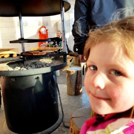 Cooking sausages at Rosa and Rudolph Family Park in Finland