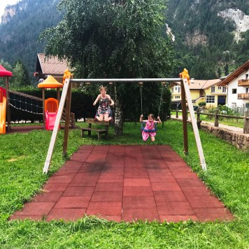 Swings at the play area at Aparthotel Majestic, Predazzo