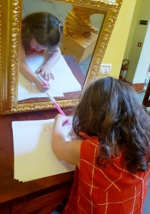 Trying mirror-writing at the Leonardo da Vinci Museum, Florence