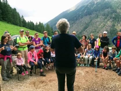 Explaining how farm life works at Malga Pampeago, Italy