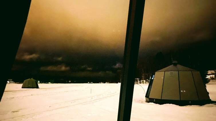 A Dark and Forlorn Sky Above Arctic Guesthouse & Glass Igloos