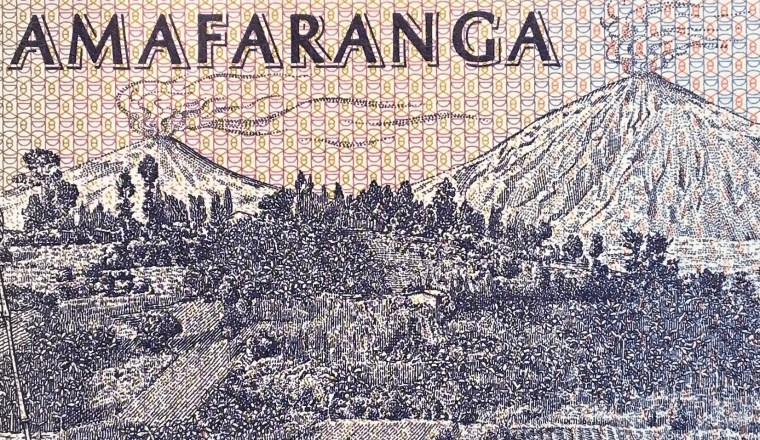 closeup detail of Rwanda 100 Francs Banknote, Year 1989 back, featuring volcanoes Karisimbi and Bisoke