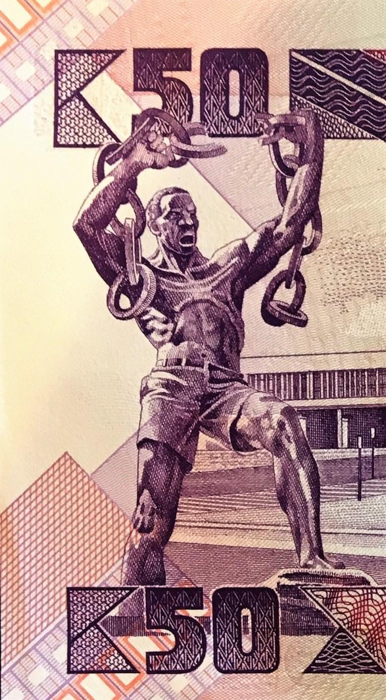 "closeup detail of Zambia 50 Kwacha Banknote, featuring  Zanco Mpundu Mutembo as ""Chain Breaking Man"""