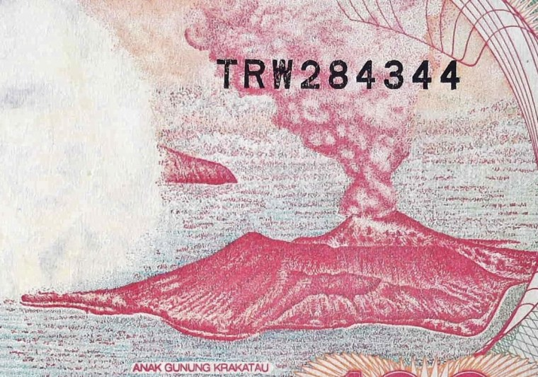 closeup detail of Indonesia 100 Rupiah Banknote, Year 1992 back, featuring eruption of Krakatau