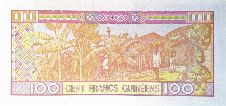 Guinea 100 Francs Banknote  back, featuring banana harvest