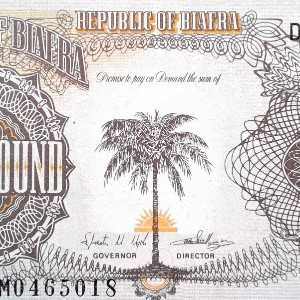 Biafra 1 Pound banknote face featuring palm tree in foreground before rising sun
