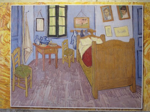 Reproduction of painting of his bedroom by Vincent Van Gogh.