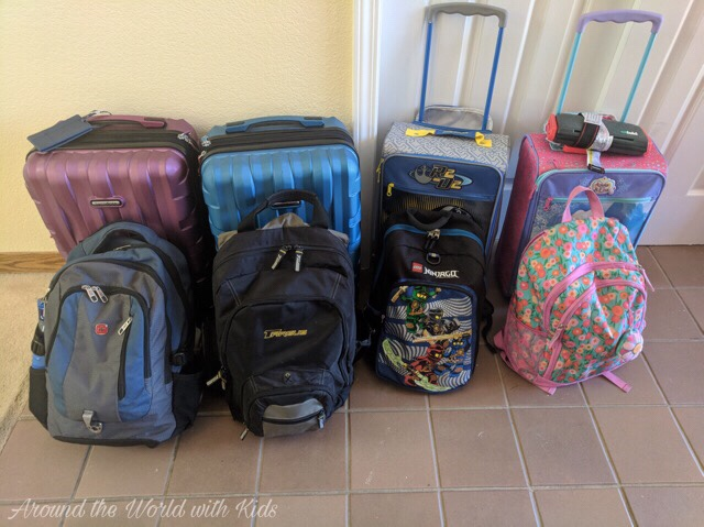 4 carry on suitcases and 4 backpacks