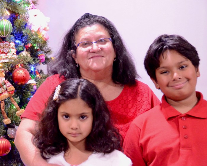 Grandmother with her two grandchildren, a boy and a girl