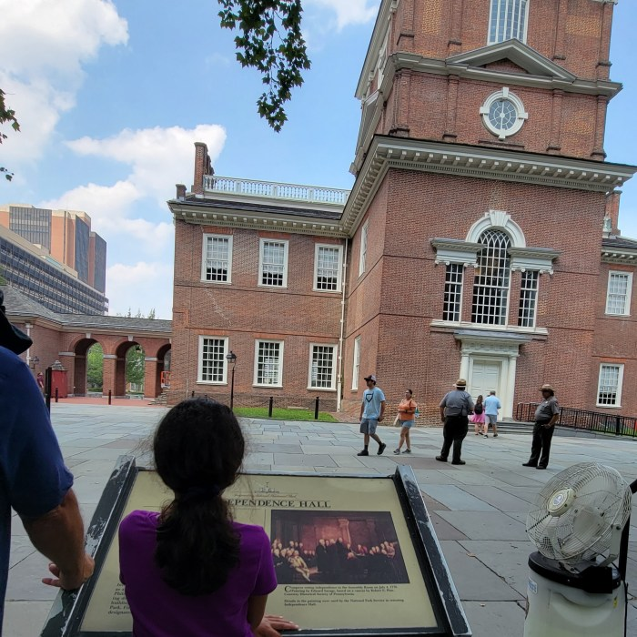 Reading a plaque in Independence Square