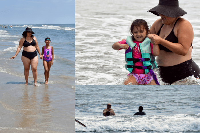 A mom and child walking on the beach, a mom and toddler playing in the water, a teen and man out in the waves