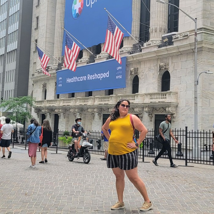 A woman in front of the New York Stock Exchange