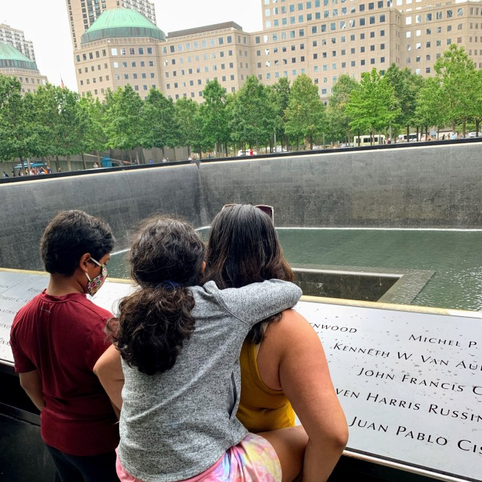 A mom and her children overlooking the 9/11 Memorial Pools