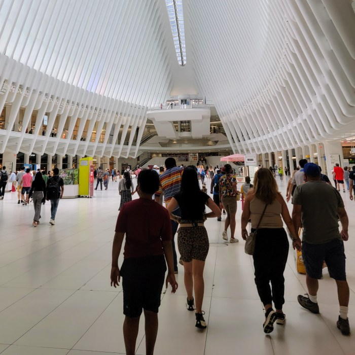 A family group walking inside the Oculus