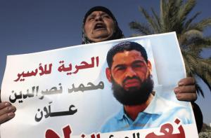 mother-of-muhammad-allan-holds-sign-afp