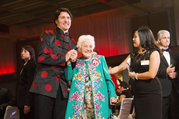 Canadian Prime Minister Justin Trudeau, left, embraces former Mississauga mayor Hazel McCallion as they attend the 27th Annual Dragon Ball Gala, in celebration of the Chinese New Year, in Toronto on Saturday, Feb. 6, 2016. THE CANADIAN PRESS/Michelle Siu