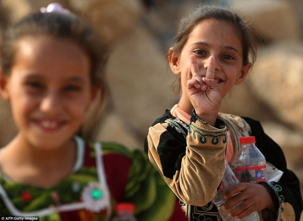 39a84c2e00000578-3866364-youngsters_in_the_village_of_al_khuwayn_south_of_mosul_couldn_t_-a-50_1477324165795