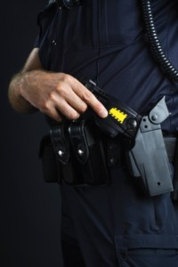 Police officer and stun gun