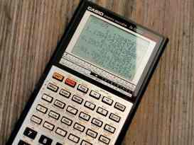 black and grey casio scientific calculator showing formula