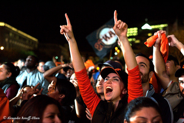 SF Giants fans celebrating the 2010 World Series victory at Civic Center in front of SF City Hall.