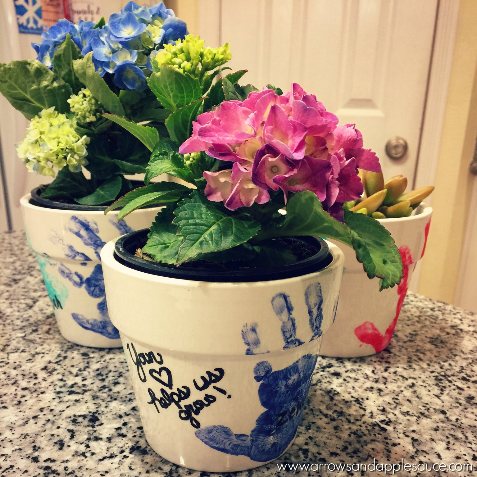 Mothers day hand print flower pots arrows applesauce these fun hand print flower pots are easy to make with your kids and make izmirmasajfo