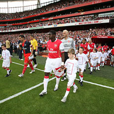Captain Kolo Toure leads out Arsenal against PSG in the Emirates Cup