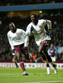 The two Emmanuel's celebrate Adebayor's goal