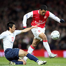 Walcott scores with his arm