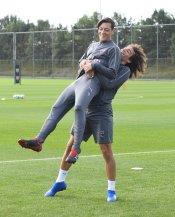 Guendouzi and Mesut Ozil in training