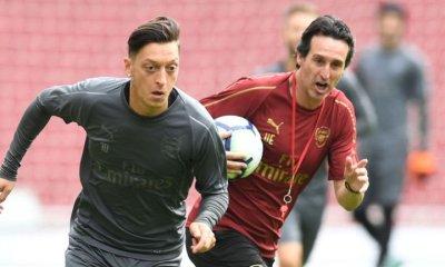 Unai Emery and Mesut Ozil