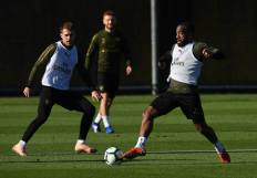ST ALBANS, ENGLAND - OCTOBER 21: Alexandre Lacazette and Aaron Ramsey of Arsenal during the Arsenal Training Session at London Colney on October 21, 2018 in St Albans, England. (Photo by David Price/Arsenal FC via Getty Images) *** Local Caption *** Aaron Ramsey; Alexandre Lacazette