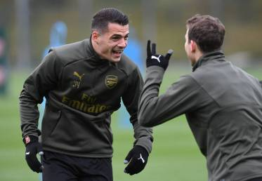 ST ALBANS, ENGLAND - OCTOBER 27: Granit Xhaka and Stephan Lichtsteiner of Arsenal during the Arsenal Training Session at London Colney on October 27, 2018 in St Albans, England. (Photo by David Price/Arsenal FC via Getty Images) *** Local Caption *** Granit Xhaka; Stephan Lichtsteiner