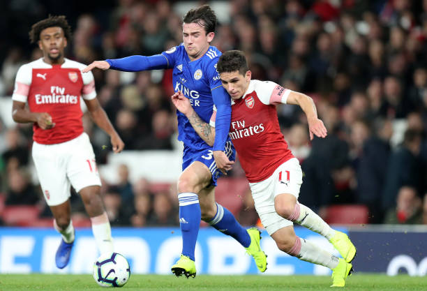 Ben-chilwell-of-leicester-and-lucas-torreira-of-arsenal-battle-for-picture-id1052764682