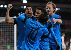 Messi double sinks Arsenal