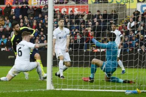 Arsenal hit Swansea City for four in comfortable win at the Liberty Stadium