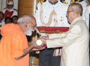 1.Swami Suddhanandaji receiving the award from President