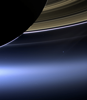 Taken on July 19, 2013, Cassini took this picture of our planet (that tiny blue dot) as it was eclipsed by Saturn.