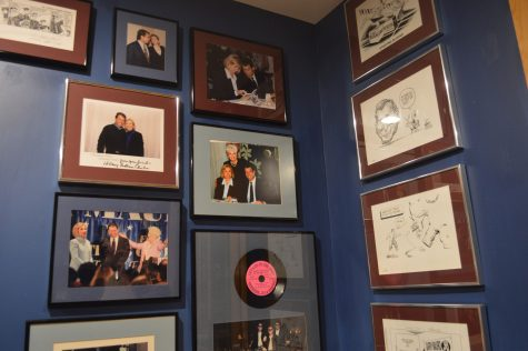 Mauro dedicates office wall space to his fellow politicians. There were photos of him with the Clintons, and Ann Richards, action shots of them at rallies and conventions, and political cartoons from previous  elections. Photo by Ally Wait.