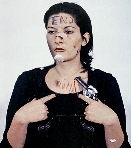 "Marina Abramović during 1974 ""Rhythm 0"" performance, photographer unknown."