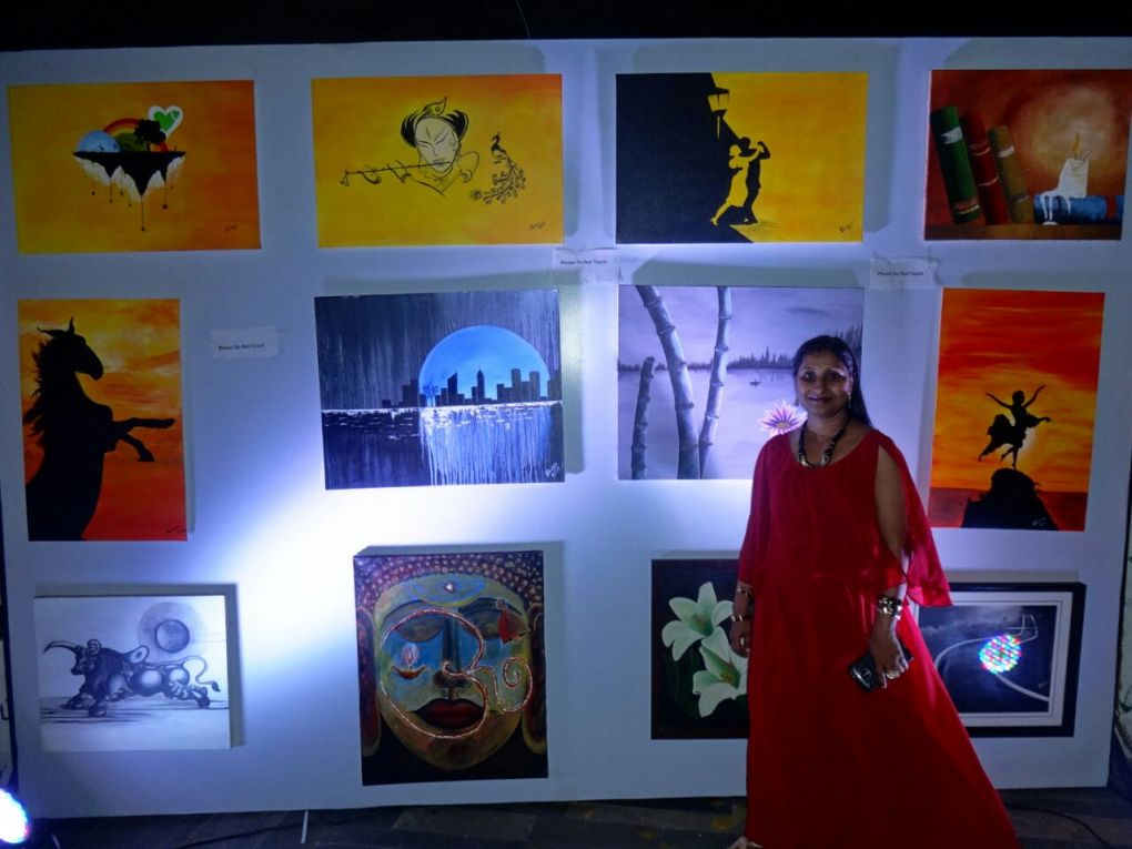 My wife with Paintings