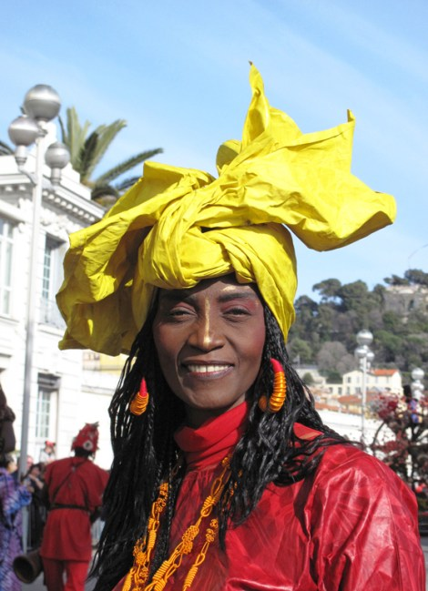Nice - France -Carnival - The battle of flowers - Woman Caribbean parading with flashy clothes