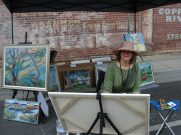 Katy Cauker paints outside the LodeStar, corner of 3rd and California