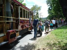 Concertgoers jump off the trolley and into Britt for the Michael Franti concert