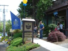 Britt flag at Elan Guest Suites & Gallery entrance