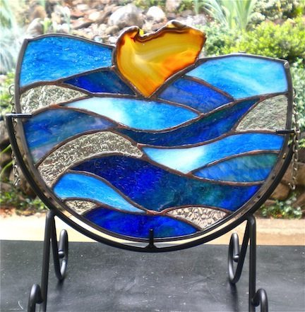 "Jannie Ledard, a published stained glass and jewelry maker, is showing one of her unique ""mandala"" pieces called ""Waves."""