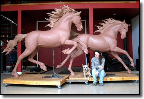 Bronze sculptor Jan van Ek with larger-than-life models that would later be cast in bronze
