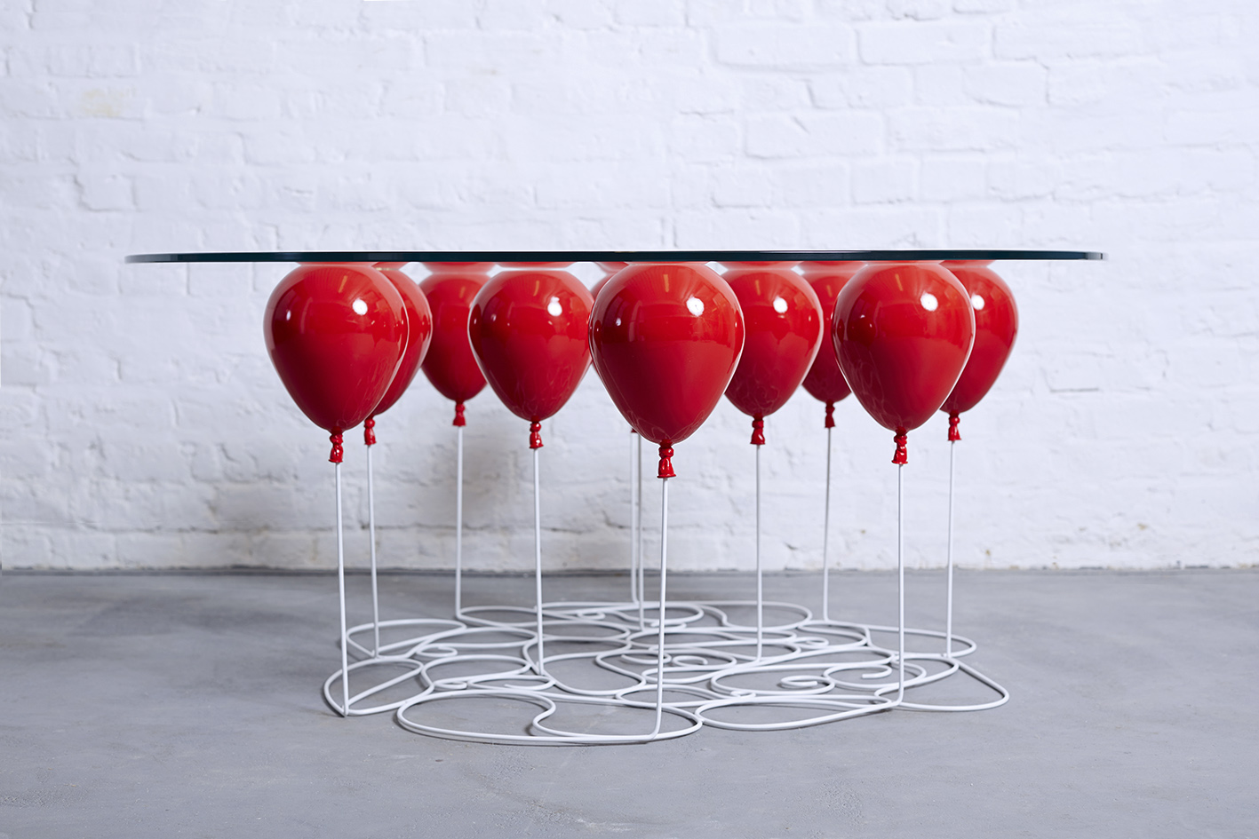 A Coffee Table Made Out Of Glass Based On 11 Helium