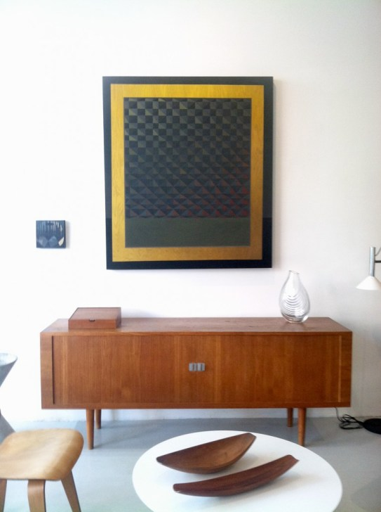 "centered: Allison Reimus. ""Yellow Rectangle,"" acrylic on wood, 2012. Hung above a teak sideboard by Hans Wegner for Ry Mobler Denmark, with other furnishings by Charles and Ray Eames, Eero Sarrinen and Jens Quistgaard."