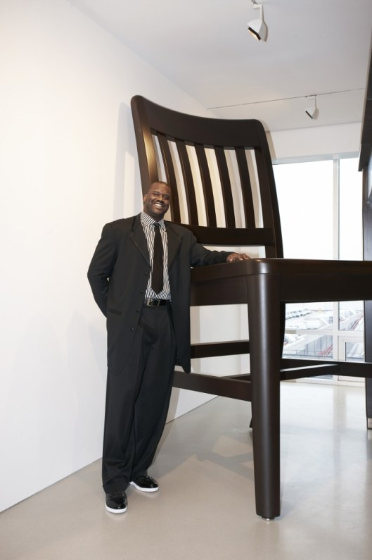 "Shaquille O'Neal standing in ""SIZE DOES MATTER,"" an exhibition he curated for the FLAG Art Foundation in 2010"